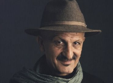 Reza, reporter-photographe engagé dans l'action humanitaire